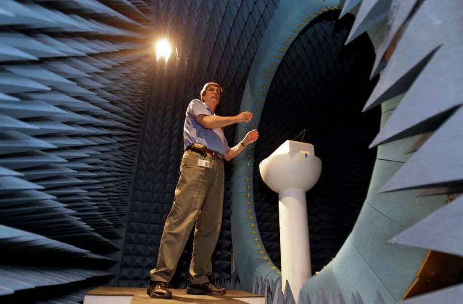 Melissa Phillip photos : Chronicle SOMETHING FROM THE STARGATE SG-1 SET?: HP compliance manager Joe Sharkey explains how an anechoic chamber is used for antenna testing at a building near HP's Houston-area campus. Photo: Melissa Phillip / © 2011 Houston Chronicle
