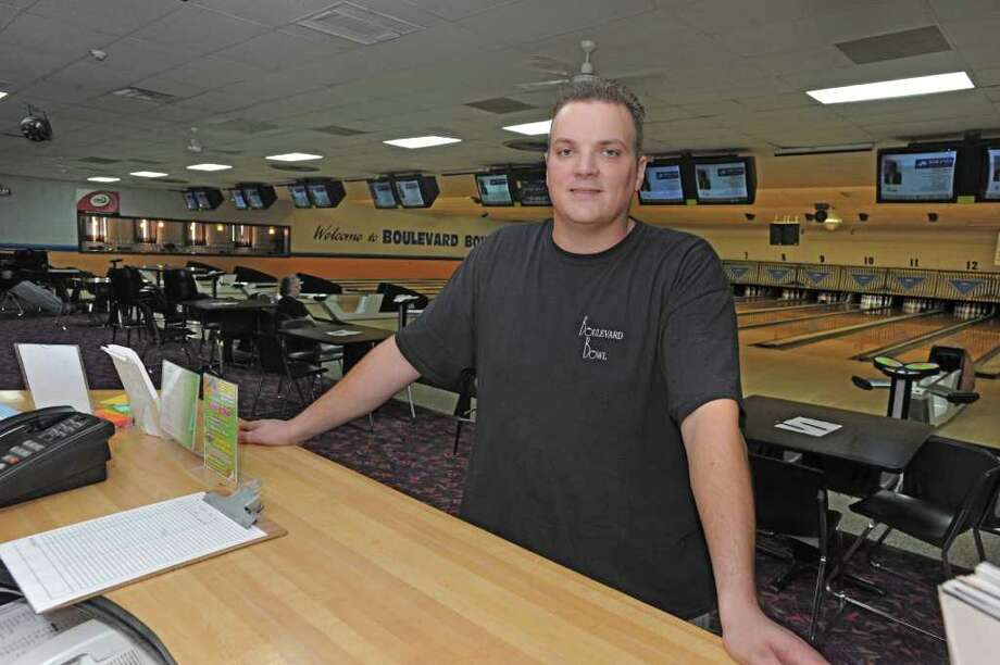Blaise Lawyer of Boulevard Bowl stands at the front desk of the bowling alley in Schenectady, N.Y. Tuesday, Sept. 27, 2011. (Lori Van Buren / Times Union) Photo: Lori Van Buren