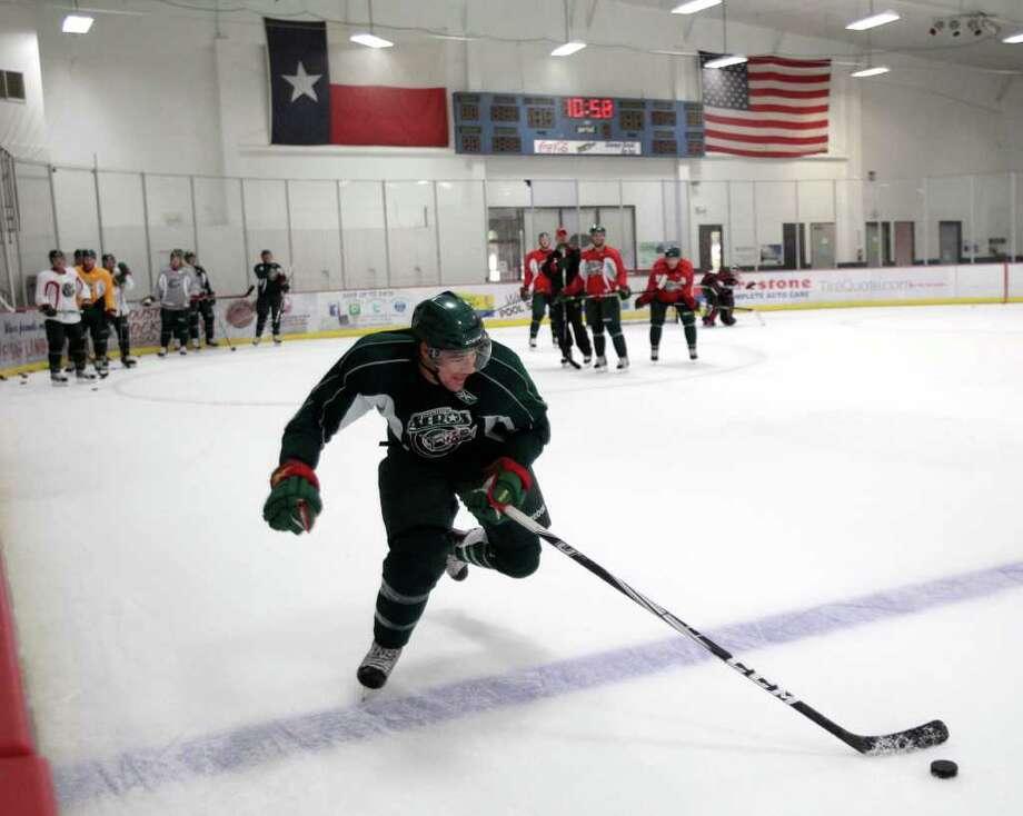 Houston Aeros right wing Jed Ortmeyer skates up the ice during Aeros' hockey training camp at the Sugar Land Ice and Sports Center Wednesday, Sept. 28, 2011, in Sugar Land. Photo: Brett Coomer, Houston Chronicle / © 2011 Houston Chronicle