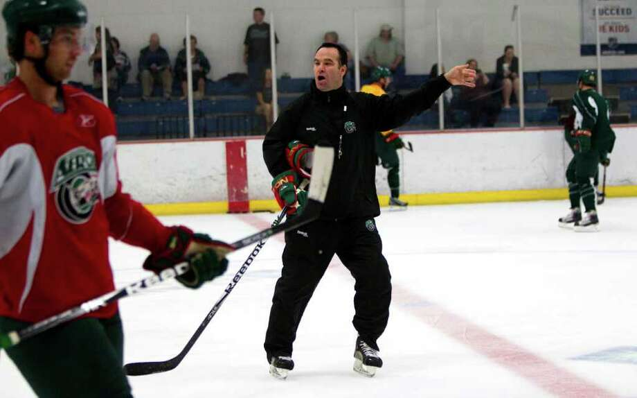Houston Aeros head coach John Torchetti runs practice during Aeros' hockey training camp at the Sugar Land Ice and Sports Center Wednesday, Sept. 28, 2011, in Sugar Land. Photo: Brett Coomer, Houston Chronicle / © 2011 Houston Chronicle