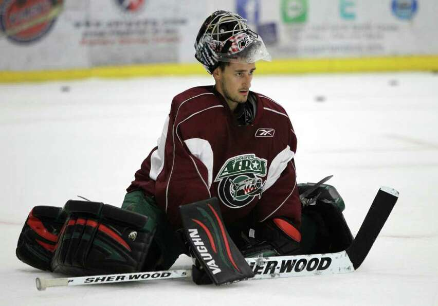 Houston Aeros goalie Dennis Endras stretches during Aeros' hockey training camp at the Sugar Land Ic
