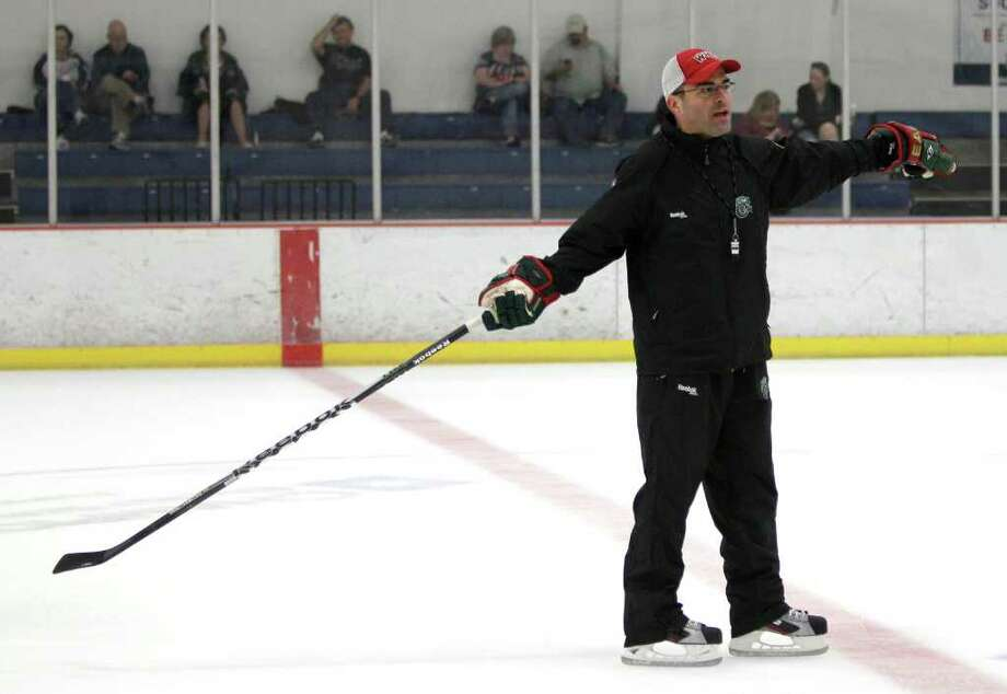 Houston Aeros assistant coach Sebastien Laplante runs a drill during Aeros' hockey training camp at the Sugar Land Ice and Sports Center Wednesday, Sept. 28, 2011, in Sugar Land. Photo: Brett Coomer, Houston Chronicle / © 2011 Houston Chronicle