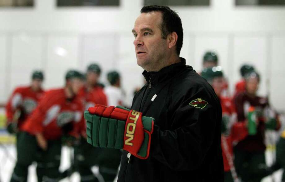Houston Aeros head coach John Torchetti watches practice during Aeros' hockey training camp at the Sugar Land Ice and Sports Center Wednesday, Sept. 28, 2011, in Sugar Land. Photo: Brett Coomer, Houston Chronicle / © 2011 Houston Chronicle