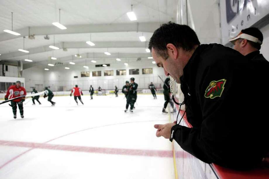 Houston Aeros head coach John Torchetti times a scrimmage during Aeros' hockey training camp at the Sugar Land Ice and Sports Center Wednesday, Sept. 28, 2011, in Sugar Land. Photo: Brett Coomer, Houston Chronicle / © 2011 Houston Chronicle