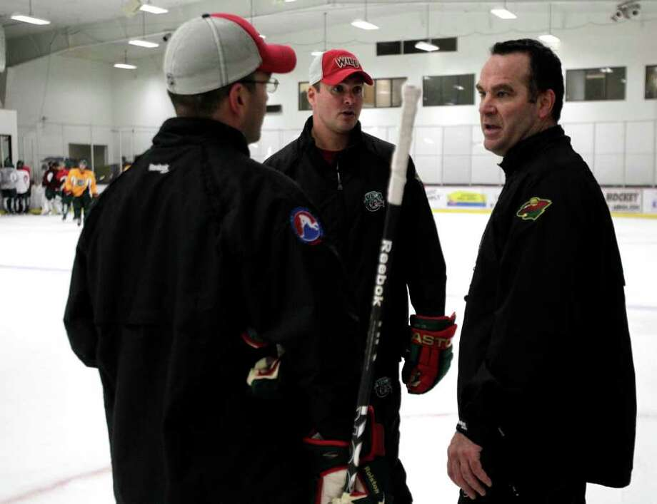 Houston Aeros head coach John Torchetti, right, talks with his assistants Sebastien Laplante, left, and Mike Van Ryn during Aeros' hockey training camp at the Sugar Land Ice and Sports Center Wednesday, Sept. 28, 2011, in Sugar Land. Photo: Brett Coomer, Houston Chronicle / © 2011 Houston Chronicle
