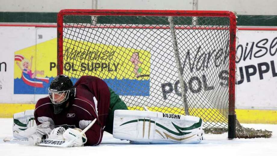 Houston Aeros goalie Darcy Kuemper stretches in front of the net during Aeros' hockey training camp at the Sugar Land Ice and Sports Center Wednesday, Sept. 28, 2011, in Sugar Land. Photo: Brett Coomer, Houston Chronicle / © 2011 Houston Chronicle
