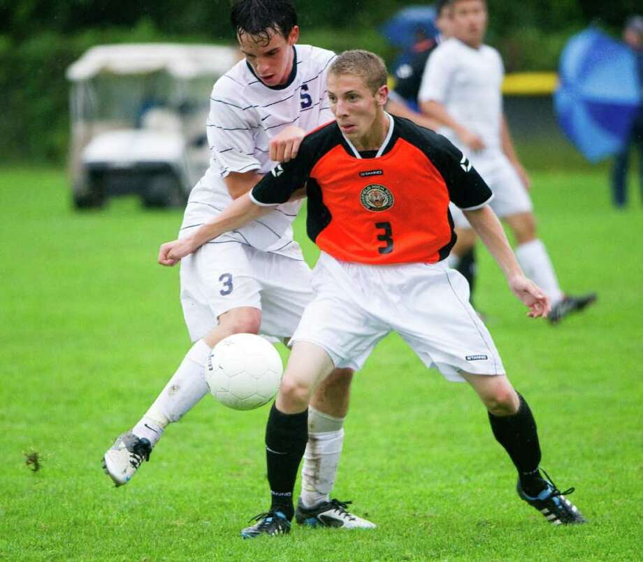Staples' Ben Root and Ridgefield's Travis Leiter in action as Staples High School hosts Ridgefield in a boys soccer game in Westport, Conn., Sept. 28, 2011. Photo: Keelin Daly / Stamford Advocate