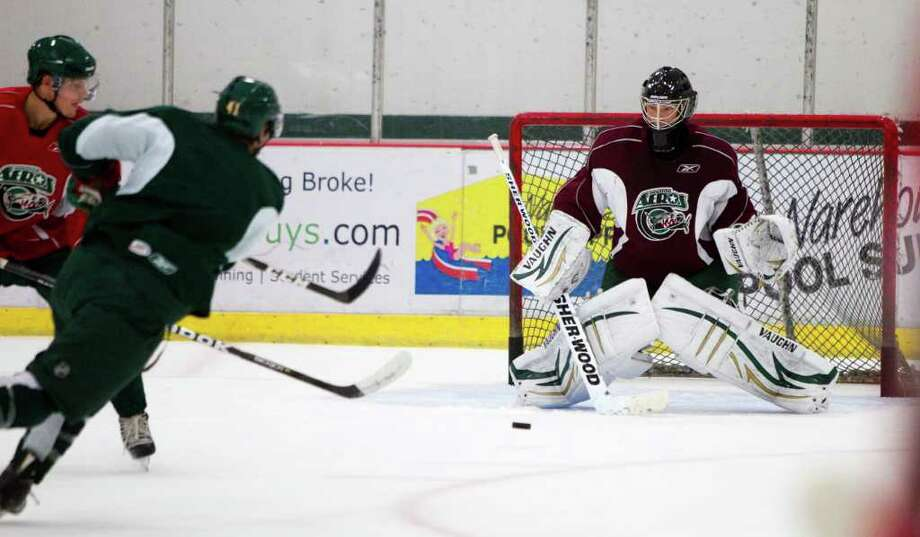 Houston Aeros right wing Jed Ortmeyer (41) takes a shot on goal against goalie Darcy Kuemper during Aeros' hockey training camp at the Sugar Land Ice and Sports Center Wednesday, Sept. 28, 2011, in Sugar Land. Photo: Brett Coomer, Houston Chronicle / © 2011 Houston Chronicle