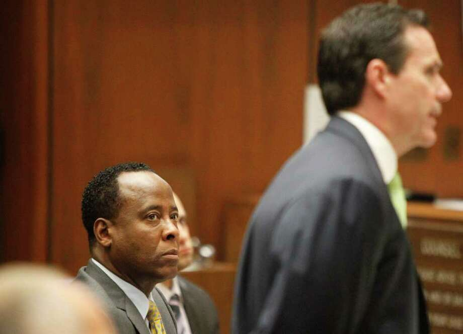 Conrad Murray watches his attorney, Edward Chernoff, question concert promoter Paul Gongaware on the second day of his involuntary manslaughter trial in the death of pop star Michael Jackson in downtown Los Angeles,  Wednesday, Sept. 28, 2011.  Murray has pleaded not guilty and  faces four years in prison and the loss of his medical license if convicted of involuntary manslaughter.  (AP Photo/Al Seib, Pool) Photo: Al Seib / Pool, Los Angeles Times