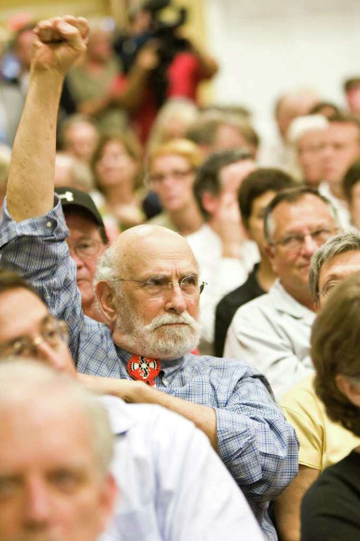 In 2009, Charlie McCarthy shows his support for the project's opponents at a meeting held at Poe Elementary.