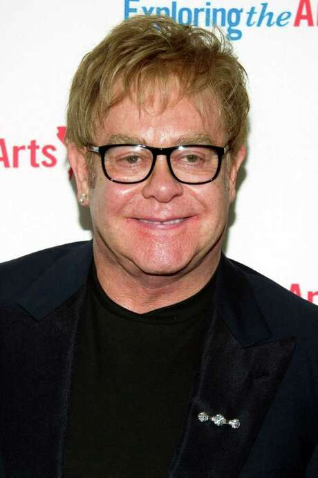 "This Sept. 18, 2011 photo shows Sir Elton John attending Tony Bennett's 85th birthday gala in New York. Elton John is returning to Las Vegas for a three-year headlining gig at Caesars Palace. The five-time Grammy winner was set to perform Wednesday Sept. 28, 2011 for the first of 16 shows scheduled through October, the first performances of a new show titled ""The Million Dollar Piano.""  (AP Photo/Charles Sykes) Photo: Charles Sykes / AP2011"