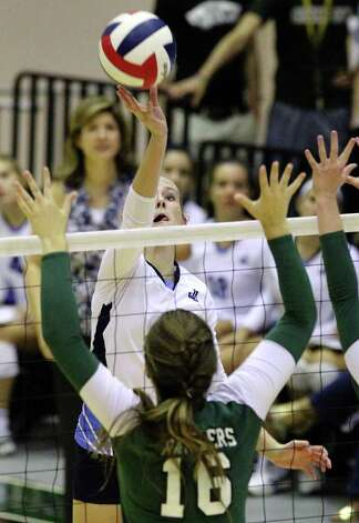 Johnson's Katie Frietag (09) attempts to finesse a shot over Reagan's Ashton Korona (16) in volleyball at Littleton Gym on Wednesday, Sept. 28, 2011. Johnson defeated Reagan in five games. Kin Man Hui/kmhui@express-news.net Photo: Kin Man Hui, -- / San Antonio Express-News