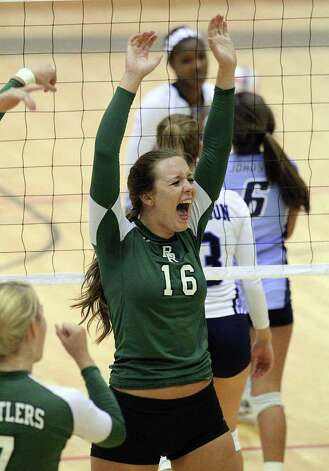 Reagan's Ashton Korona (16) reacts after a point against Johnson in volleyball at Littleton Gym on Wednesday, Sept. 28, 2011. Johnson defeated Reagan in five games. Kin Man Hui/kmhui@express-news.net Photo: Kin Man Hui, -- / San Antonio Express-News