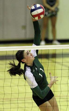 Reagan's Ashlie Reasor (11) attempts to score against Johnson in volleyball at Littleton Gym on Wednesday, Sept. 28, 2011. Johnson defeated Reagan in five games. Kin Man Hui/kmhui@express-news.net Photo: Kin Man Hui, -- / San Antonio Express-News