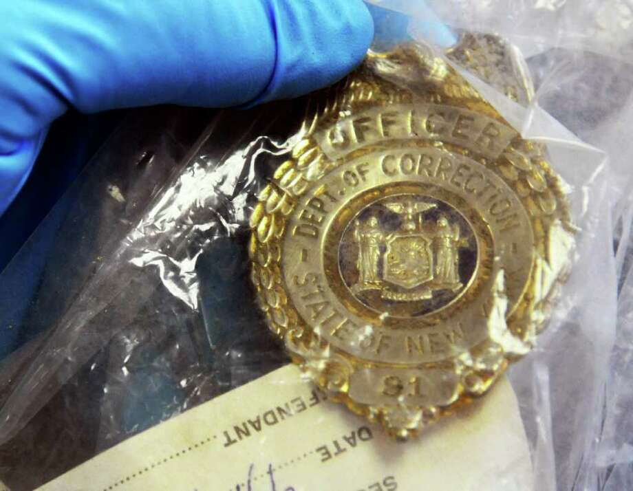 A corrections officer's badge, part of a new trove of archival items from the controversial Attica prison uprising 40 years ago, now at the NYS Museum in Albany Wednesday Sept. 21, 2011.   (John Carl D'Annibale / Times Union) Photo: John Carl D'Annibale / 00014710A