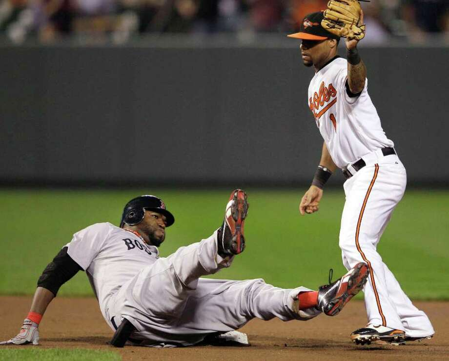 PATRICK SEMANSKY : ASSOCIATED PRESS XXX: Boston Red Sox's David Ortiz reacts after being tagged out by Baltimore Orioles second baseman Robert Andino in the seventh inning of a baseball game Wednesday, Sept. 28, 2011, in Baltimore. Photo: Patrick Semansky / AP