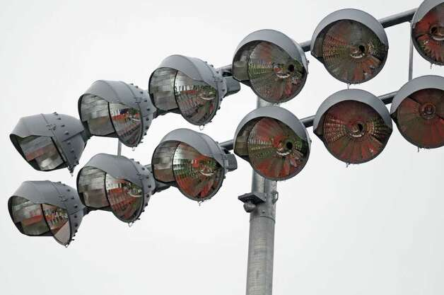 View of the new lights at Troy High School's football field, seen during practice on Wednesday Sept. 28, 2011 in Troy, NY.  ( Philip Kamrass / Times Union) Photo: Philip Kamrass / 00014782A