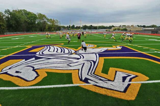 Troy High School football players practice on their new turf field on Wednesday Sept. 28, 2011 in Troy, NY.  ( Philip Kamrass / Times Union) Photo: Philip Kamrass / 00014782A