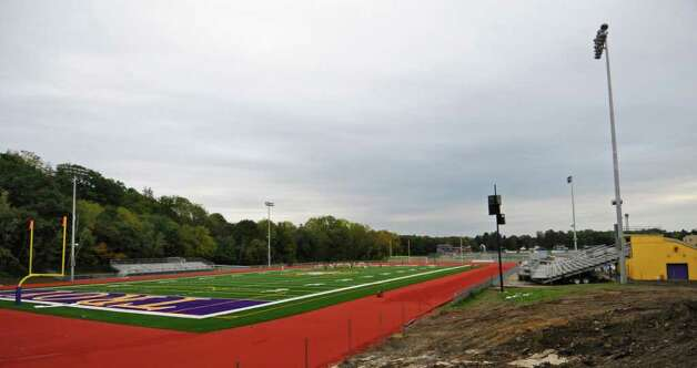View of the new lights and turf at Troy High School's football field, seen during practice on Wednesday Sept. 28, 2011 in Troy, NY.  ( Philip Kamrass / Times Union) Photo: Philip Kamrass / 00014782A