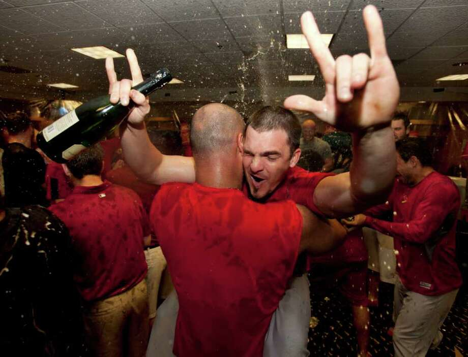 Sept. 28: Cardinals 8, Astros 0. St. Louis' Ryan Theriot and his teammates celebrate their wild-card berth in the National League baseball playoffs, after beating the Houston Astros 8-0 Wednesday, Sept. 28, 2011, in Houston. The win, coupled with the Braves' loss to the Phillies, put the Cardinals in the playoffs. (AP Photo/David J. Phillip) Photo: David J Phillip, Associated Press / Copyright: AP