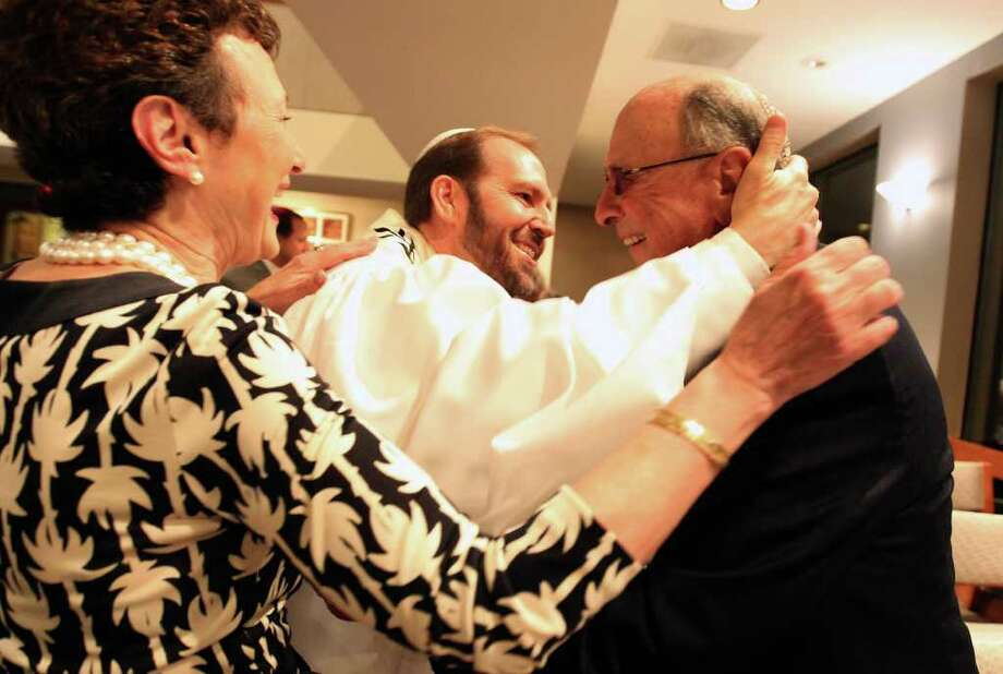 Hazzan Jeremy Lipton (center) greets longstanding congregation members Madeline and Charles Cytrin before the Erav Rosh Hashanah service Wednesday night, Sept. 28, 2011 at Agudas Achim. Photo: Jennifer Whitney/Special To The Express-News / special to the Express-News