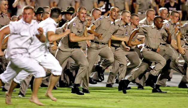 A&M Corps cadets charge onto the field to catch yell leaders after the Aggies defeated Montana at Kyle Field. Photo: TOM REEL, SAN ANTONIO EXPRESS-NEWS / SAN ANTONIO EXPRESS-NEWS