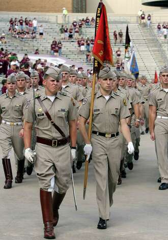 Texas A&M Cadet Corp march past the crowd at Kyle Field in College Station Saturday Sept.9, 2006. Photo: DELCIA LOPEZ, SAN ANTONIO EXPRESS-NEWS / SAN ANTONIO EXPRESS-NEWS