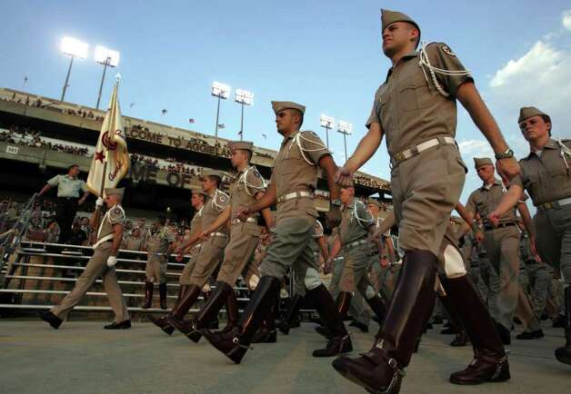 Members of the Texas A&M Corps of Cadets march into a nearly empty Kyle Field during their pregame review before A&M played Texas State on Thursday, Sept. 22, 2005, in College Station. The game was moved up from Saturday because of Hurriane Rita. Photo: MICHAEL MULVEY, AP / THE DALLAS MORNING NEWS