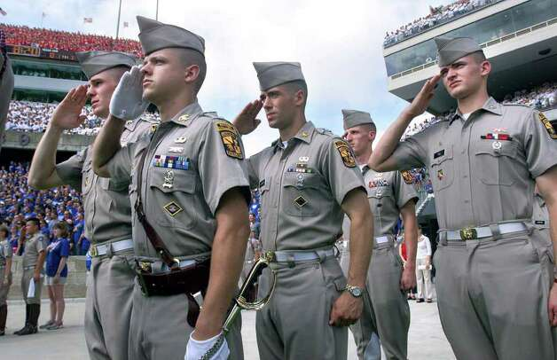 Texas A&M Corps Cadets (from left) Christian Stone, Matt Dunne, Colin Johnson, Cassidy Eaves, and  Justin Tice salute during the national anthem Saturday at Kyle Field before the Oklahoma State game. Photo: TOM REEL , EN / EN