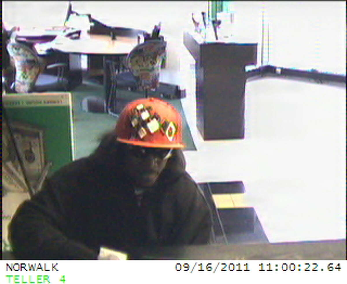Surveillance video from the TD Bank branch at 184 Main St. in Norwalk showing the suspect wanted for a robbery Friday morning.