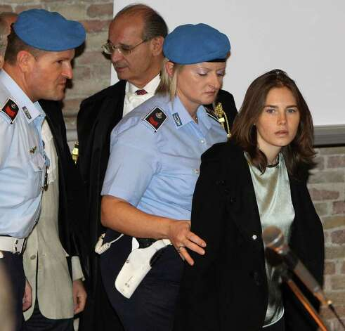 PERUGIA, ITALY - SEPTEMBER 29:  Amanda Knox (R) is escorted to her appeal hearing at Perugia's Court of Appeal on September 29, 2011 in Perugia, Italy. Amanda Knox and Raffaele Sollecito are awaiting the verdict of their appeal that could see their conviction for the murder of Meredith Kercher overturned. American student Amanda Knox and her Italian ex-boyfriend Raffaele Sollecito, who were convicted in 2009 of killing their British roommate Meredith Kercher in Perugia, Italy in 2007, have served nearly four years in jail after being sentenced to 26 and 25 years respectively. Photo: Oli Scarff, Getty Images / 2011 Getty Images
