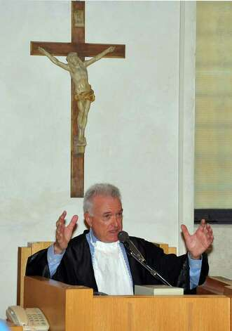 Judge Claudio Portillo Helmann gestures as he talks during an appeal hearing for the murder of British student Meredith Kercher at the Perugia court,central Italy, Thursday, Sept. 29, 2011. Amanda Knox, an American student, was convicted of sexually assaulting and murdering Meredith Kercher, her British roommate in Perugia, and sentenced to 26 years in prison. Knox's boyfriend at the time of the 2007 murder, Raffaele Sollecito of Italy, was convicted of the same charges and sentenced to 25 years. Both deny wrongdoing and have appealed the December 2009 verdict. Photo: Stefano Medici, AP / AP