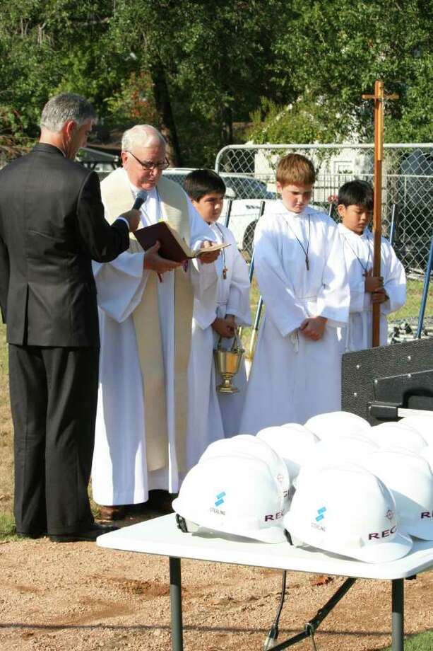 COURTESY PHOTO BLESSING THE BEGINNING: A ceremony was held to bless the The Regis School Student Life Center construction site. Jeff Manley, chairman of The Regis School Board of Directors; left, Most Reverend Vincent M. Rizzotto, Auxiliary Bishop Emeritus of Galveston-Houston; Diego Martinez, Jacob Manley and Nicholas Ellerbe were part of the event. Photo: Courtesy