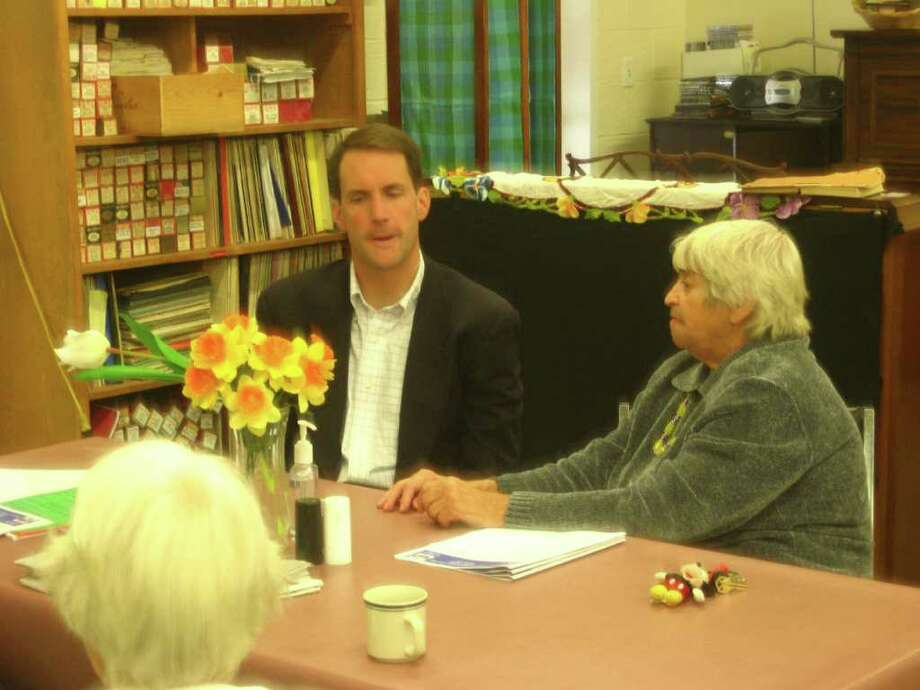 Congressman Jim Himes (D-4) speaks with Darien resident Madeline Boccuzzi after he adressed Darien seniors at the senior center Wednesday morning. Photo by Thomas Michael Photo: Contributed Photo