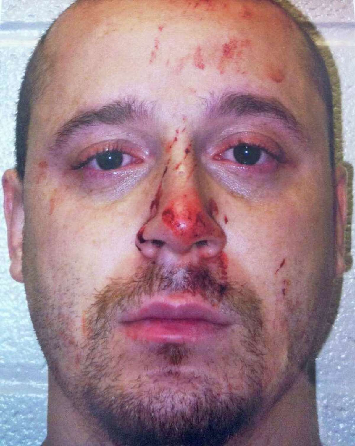 Christian Vasquez, 30, of Washington Village, Norwalk was charged with attempted murder after he flew into a rage during an argument with the 32-year-old mother of his young son and stabbed her several times early Thursday morning. The fight began over a disagreement with the mother of his 2-year-old son about her disciplining the boy too harshly. The blood all over his face came from his victim.