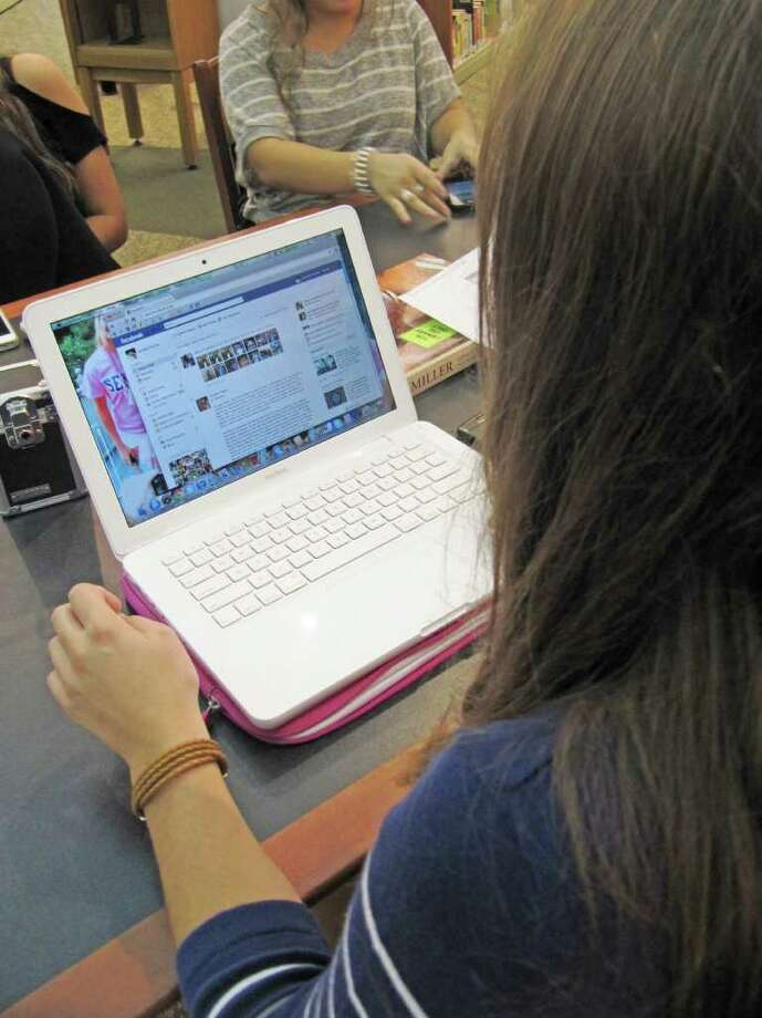 Staples High School senior Amanda Pacilio logs onto Facebook.com while at the school's library Tuesday afternoon. John Dodig, Staples' principal, announced on Aug. 25 he was lifting a nearly five-year ban of the social networking site. In nearby Fairfield, all social networking sites are banned district-wide. Photo: Contributed Photo / Westport News contributed