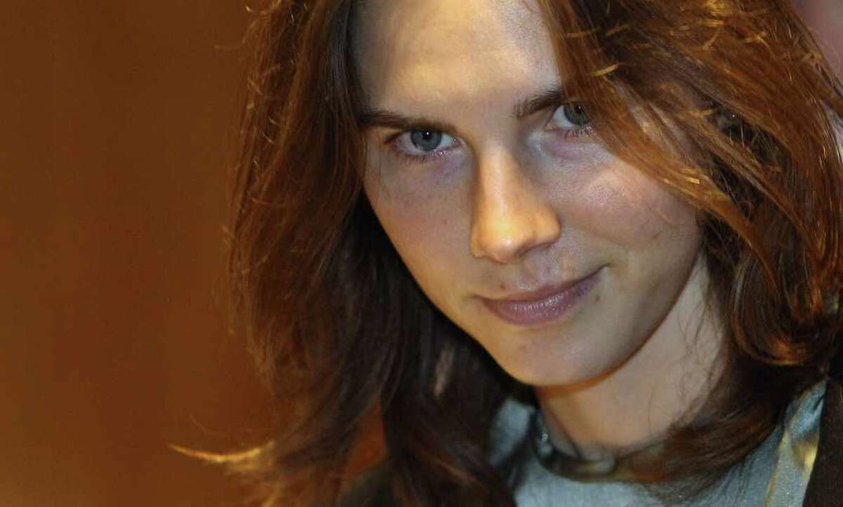 Amanda Knox is escorted to her appeal hearing at Perugia's Court of Appeal on Thursday.