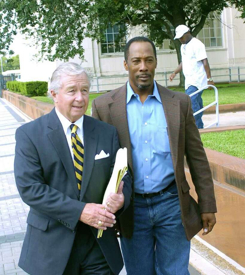 Calvin Walker, right, and his attorney, Dick DeGuerin, leave the Jack Brooks Federal Building on Thursday morning for the lunch break.  A change of venue hearing for Walker's trial started Thursday. DeGuerin has asked Judge Ron Clark to move the case out of the area, citing widespread media coverage and racism in Beaumont. Photo: Dave Ryan