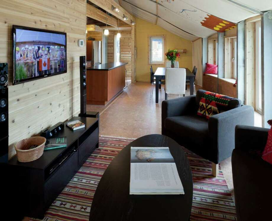 The interior of TRTL (Technological Residence, Traditional Living), by the University of Calgary, is seen at the U.S. Department of Energy Solar Decathlon 2011, in Washington, D.C. The house is inspired by native tepees and designed to provide housing for Canadian First Nations people. Features include: