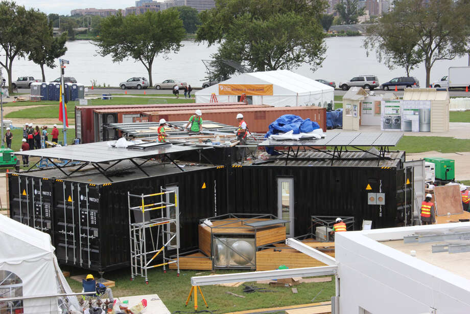 Team China works on Y Container at the U.S. Department of Energy Solar Decathlon 2011, in Washington, D.C. The house combines six recycled shipping containers into Y-shaped house designed for easy transport and assembly, and affordability for young couples in pricey Shanghai. It features: Solar heat collection for hot water and floor heating; Vacuum insulation and phase-change materials that block heat transfer and moderate the interior temperature; A natural ventilation tunnel in the middle of the house that regulates air distribution and the fresh air supply without using energy. Photo: Stefano Paltera/U.S. Department Of Energy Solar Decathlon