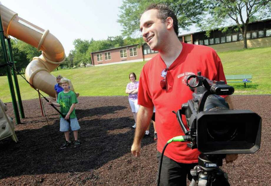 Mike Feurstein, a local filmmaker, works on filming a promo for his recent anti-bullying film with school children at Glendaal Elementary School in Scotia, NY Friday Aug. 19,2011.( Michael P. Farrell/Times Union) Photo: Michael P. Farrell