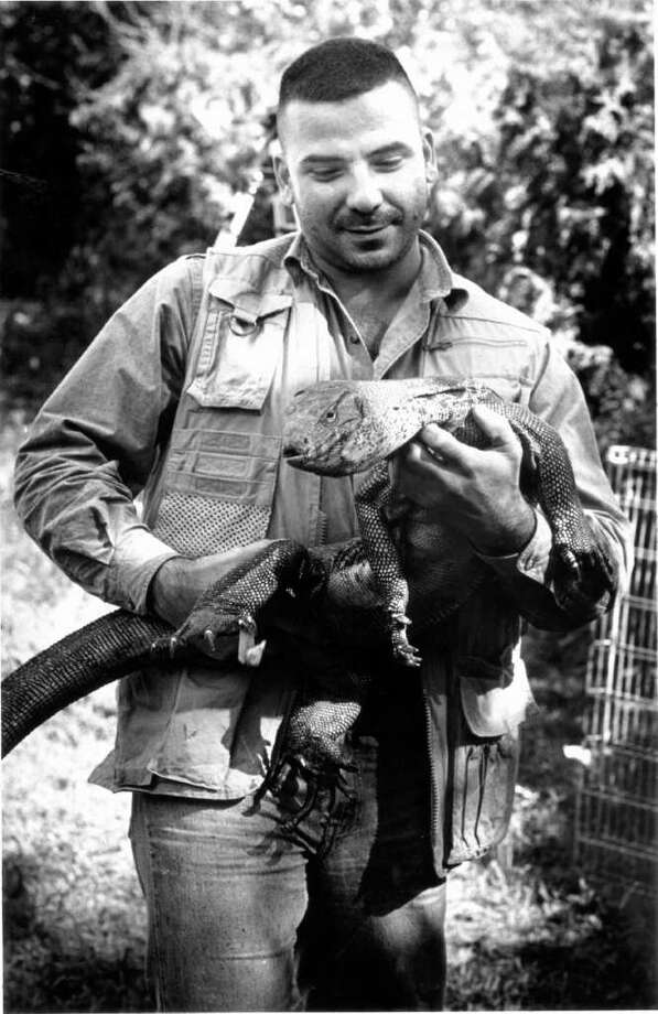 Oct. 6, 1986: Albert Kilian holds Lenny the Lizard while talking to media about the reptile's seven weeks in the wild. Photo: File Photo
