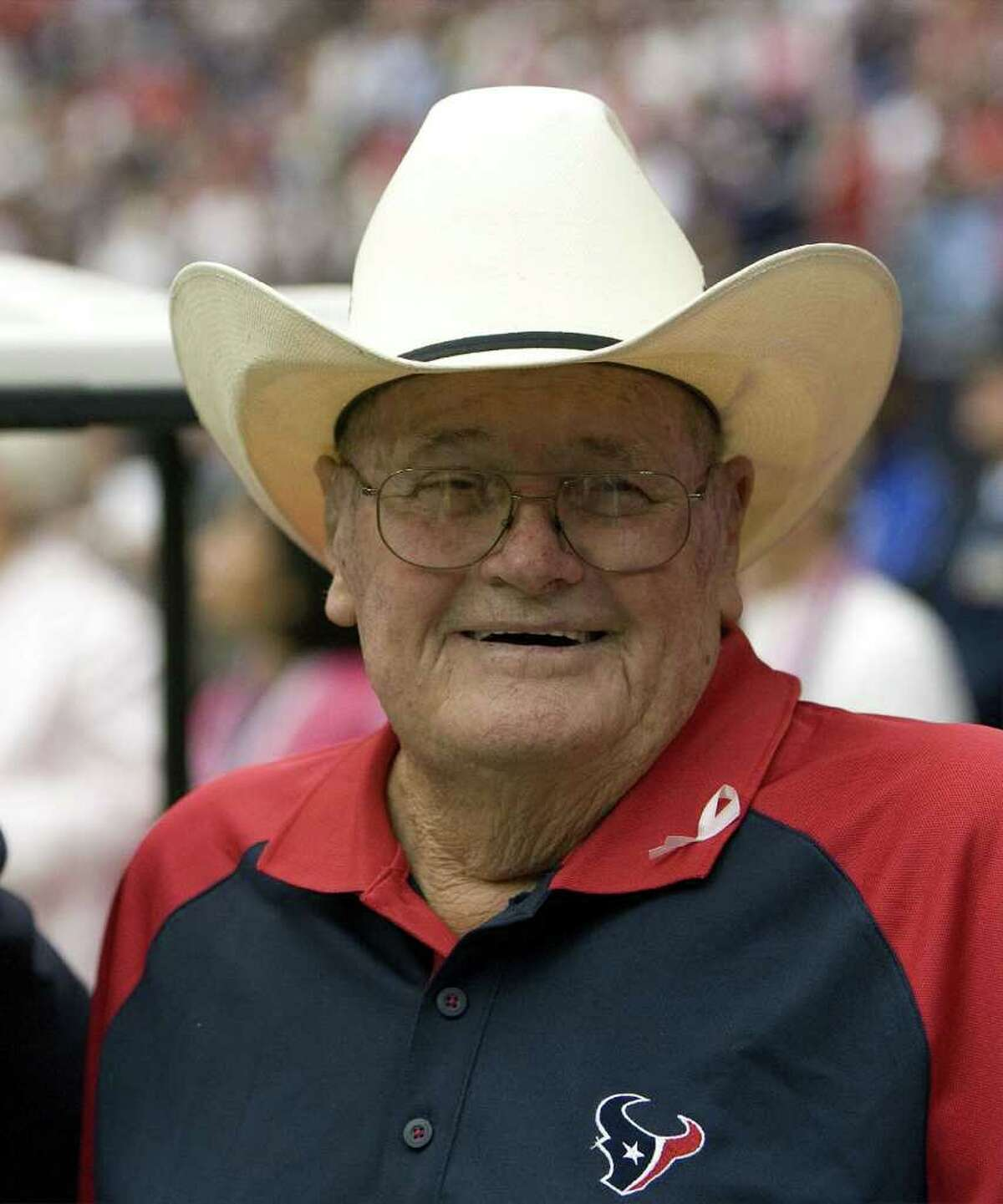 Legendary football coach Bum Phillips is rarely photographed these days without his signature cowboy hat. Phillips will be in Port Neches Friday night to watch the Mid County Madness game between the Nederland Bulldogs and Port Neches Indians. Houston Chronicle file photo