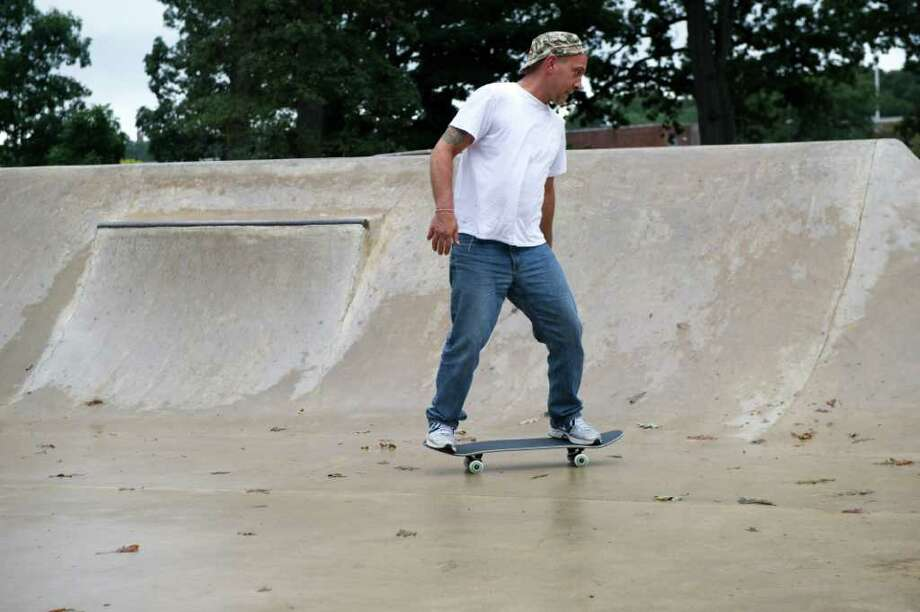 Joey Spoto hones his skills among the skateboarders at Scalzi Skate Park in Scalzi Park on Bridge Street in Stamford Conn., Sept. 29, 2011. The city is weighing whether to keep the park open in the more moderate part of the winter. Photo: Keelin Daly / Stamford Advocate