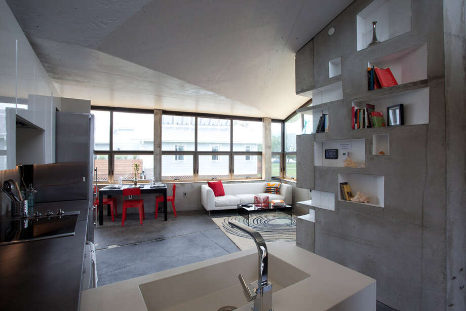 The interior of ENJOY House, by Team New Jersey (Rutgers and the New Jersey Institute of Technology) is seen at the U.S. Department of Energy Solar Decathlon 2011, in Washington, D.C. The house is designed for a couple retiring to the Jersey shore and features: