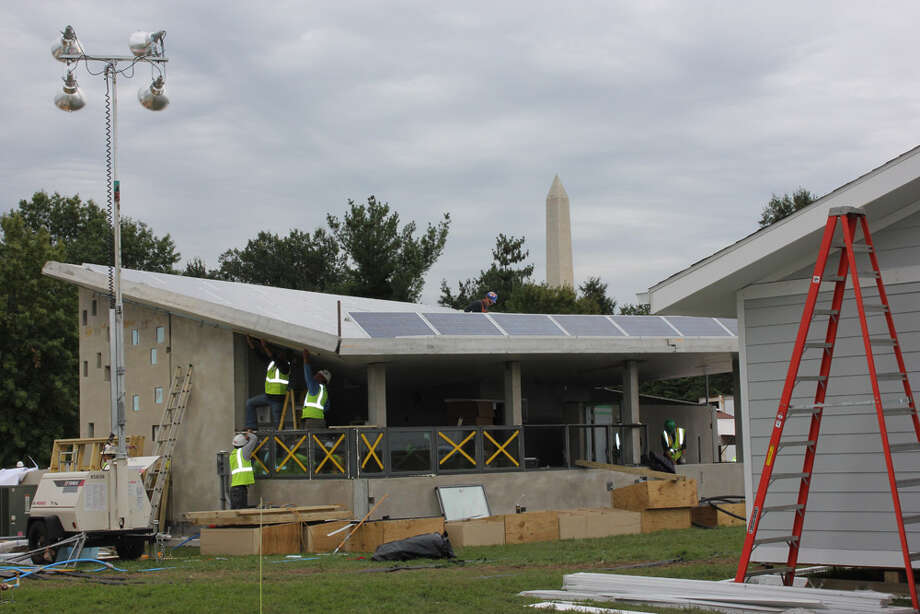 Team New Jersey (Rutgers and the New Jersey Institute of Technology) works on ENJOY House at the U.S. Department of Energy Solar Decathlon 2011, in Washington, D.C. The house is designed for a couple retiring to the Jersey shore and features: