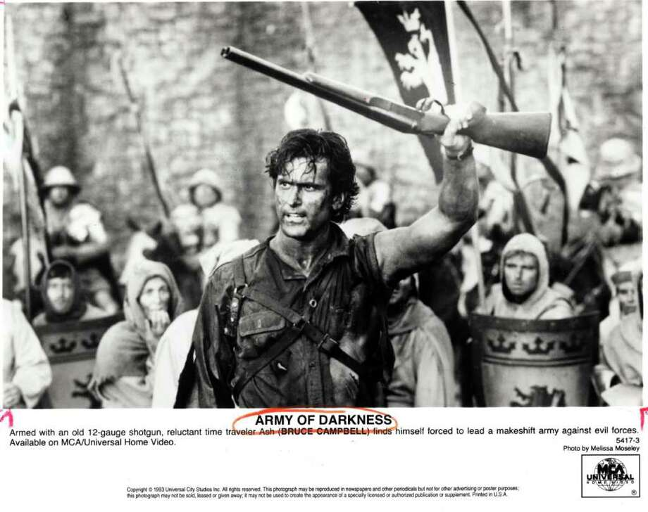 Melissa Moseley : Universal City Studios Inc. SEQUEL: Reluctant time traveler Ash (Bruce Campbell) leads a makeshift army against evil forces in Army of Darkness ('92). Photo: Melissa Moseley / handout