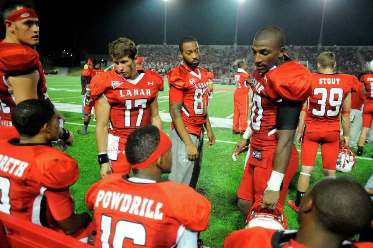 Cardinals wide receiver J.J. Hayes, center, talks with teammate Josh Powdrill during a rest on the sidelines in the first half against Incarnate Word at Provost Umphrey Stadium Saturday, September 17, 2011. Valentino Mauricio/The Enterprise