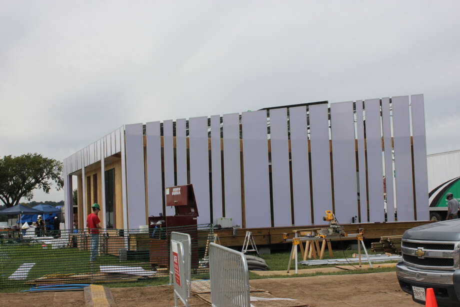 The exterior of enCORE, by The Ohio State University, is shown under construction at the U.S. Department of Energy Solar Decathlon 2011, in Washington, D.C. The house features: An adjustable exterior screen that provides privacy and protection from the sun; A solar thermal hot air system; Natural lighting throughout the house based on activity areas. Photo: Stefano Paltera/U.S. Department Of Energy Solar Decathlon