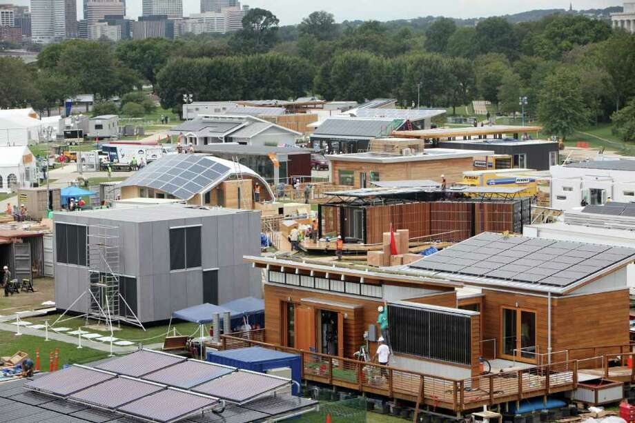 The U.S. Department of Energy Solar Decathlon challenges collegiate teams to design, build, and operate solar-powered houses that are cost-effective, energy-efficient, comfortable, healthy and attractive, harnessing the sun to produce at least as much energy and hot water as they consume. Teams and homes are rated or judged based on 10 categories: architecture, market appeal, engineering, communications, affordability, comfort zone, hot water, appliances, home entertainment and energy balance. The Department of Energy has hosted the contest every two years since 2002. The current Solar Decathlon runs through Oct. 2 in Washington, D.C. Here's an overview of teams working on their homes on Sept. 19, 2011, followed by pictures and descriptions of all of this year's entries. Photo: Stefano Paltera, Stefano Paltera/U.S. Department Of Energy Solar Decathlon / Copyright Notice: © 2011 Stefano Paltera/U.S. Department of Energy Solar Decathlon